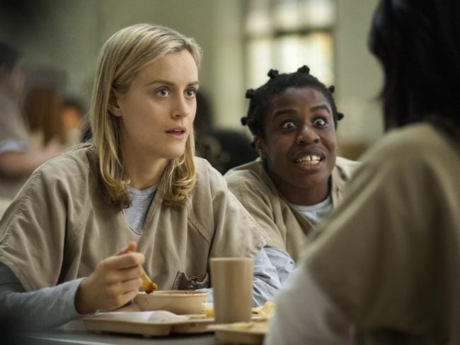 Taylor Schilling and Uzo Aduba in  <i>Orange Is the New Black</i>. Picture: AP Photo/Netflix, Paul Schiraldi