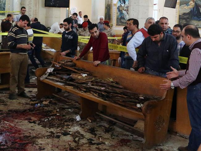 A forensics team collect evidence at the church in Tanta. Picture: AFP