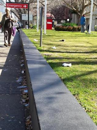Rubbish has been carelessly dropped at the hospital entrance.