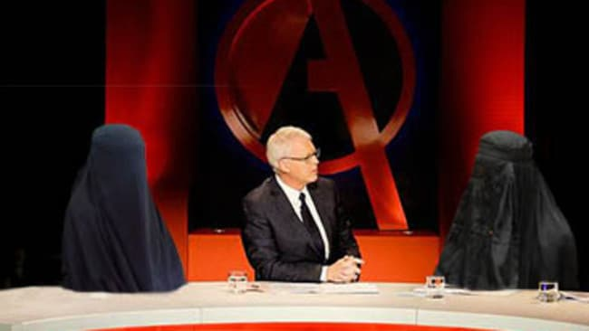 That's Tony Jones in the middle – as to the panellists – who knows?  (Image digitally altered)