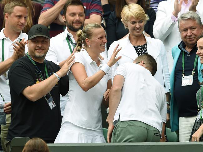 Petra Kvitova of Czech Republic celebrates with family, friends and coaches in the players box after winning the women's singles final.