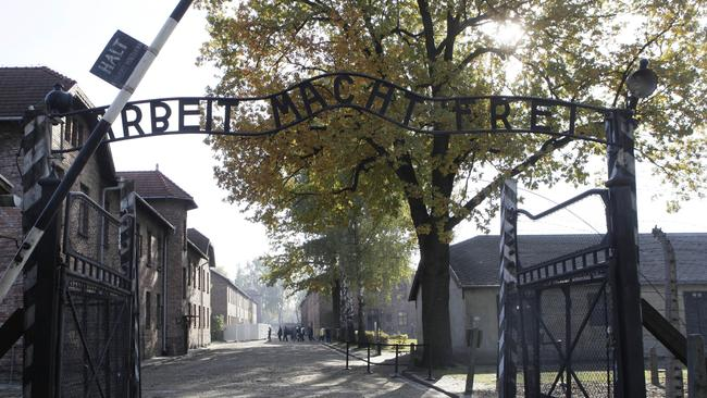 "FThe infamous entrance to Auschwitz with the inscription ""Arbeit Macht Frei"" (Work Sets You Free) . Picture: AP."