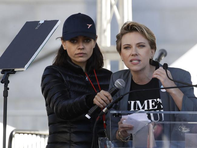 Actress Scarlett Johansson, right, speaks as Mila Kunis holds a microphone for her at a Women's March against sexual violence and the policies of the Trump administration in Los Angeles. Picture: AP