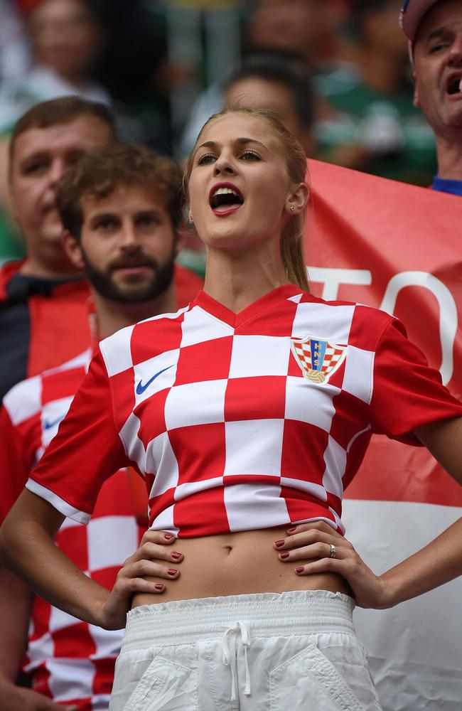 A fan of Croatia cheers before a Group A football match between Croatia and Mexico.