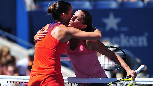 Flavia Pennetta of Italy (L) hugs Roberta Vinci of Italy (R) after Panenetta won, 6-4, 6-1, during their 2013 US Open women's singles match at the USTA Billie Jean King National Tennis Center September 4, 2013 in New York. AFP PHOTO/Stan HONDA