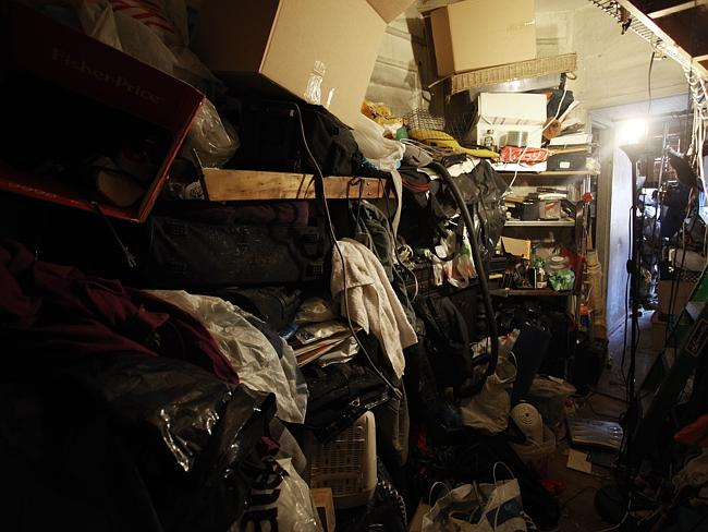 He lives surrounded by junk, shoved in cupboards and strewed around the apartment.
