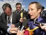 <p>Damien Oliver is swamped by media after his win on Glass Hamonium in 2011.</p>