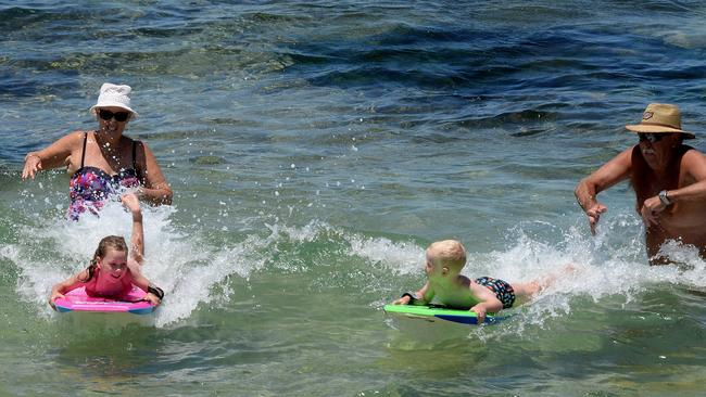 People continue to swim at Burwood Beach. Picture: Peter Lorimer