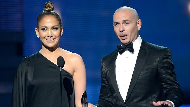 Singers Jennifer Lopez and Pitbull on stage.
