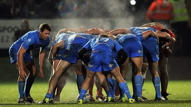 Steam rises from the pack as Italy prepare for a scrum.
