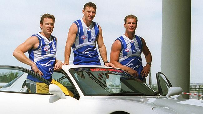 It's 2002 and the Kangas mix things up but not too much ... Here's Adam Simpson, a 24-year-old Brent Harvey and Wayne Carey.