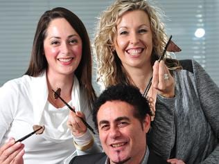 Macro Meats chief executive Ray Borda, daughter Rachael Trott and wife Narelle Borda eat roo meat with chop sticks at Macro meats in Athol Park Adelaide they are soon to exporting to Asia.