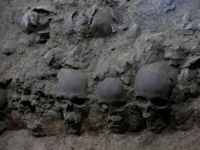 The skulls — of men, women and children — were neatly arranged and set in place with lime. Picture: PAU-INAH.