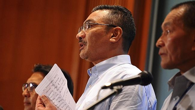 New lead ... Malaysian Defense Minister Hishammuddin Hussein (centre) shows a note from the Chinese ambassador stating they've received new satellite images. Picture: AP