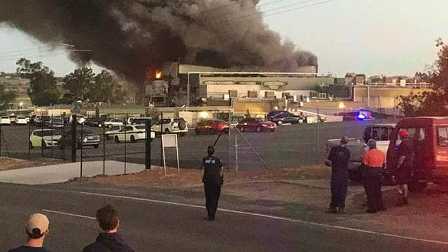 Staff and onlookers outside the Thomas Foods International's abattoir facility outside Murray Bridge. Picture: Facebook/Steven Pearson