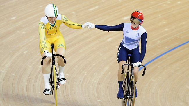 Victoria Pendleton raises the arm of Anna Meares after the Australians victory in the women's sprint final.