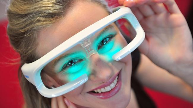 TIMELY IDEA: Ulani Parsons, heading off to the UK for the first time, tries the glasses which reset your body clock. They were developed by a Flinders University venture.