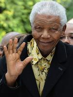 April 2009: Mandela waves after casting his vote in South Africa's general elections in Johannesburg. Picture: AFP