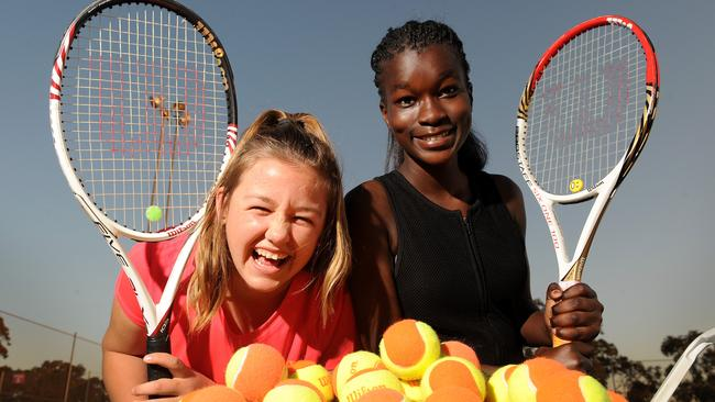 Young Grove Tennis Club members Natalie Quast and Jemima Busasa have welcomed news a mega sports hub is a step closer. Picture: Keryn Stevens