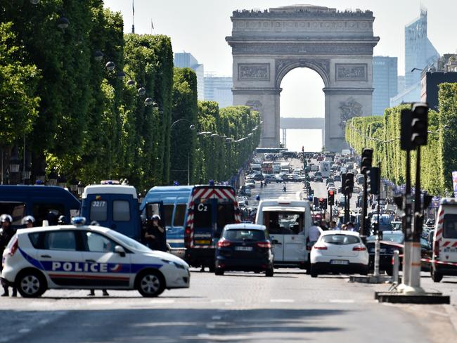 Police seal off the Champs Elysees with the Arc de Triomphe visible in the background. Picture: AFP