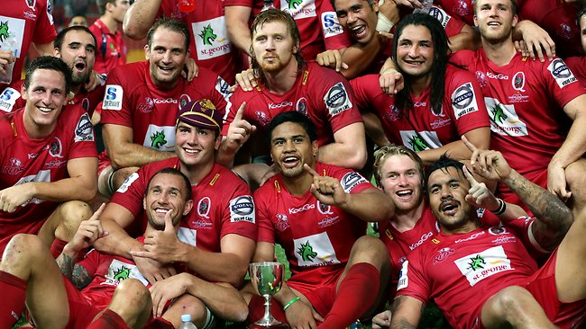 Reds players celebrate with the Bob Templeton Cup after beating the Waratahs at Suncorp Stadium. Picture: Darren England