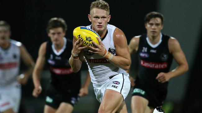 Adam Treloar is back for the Magpies. Picture: Michael Klein
