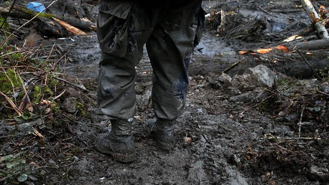 A search and rescue worker stands in debris from the deadly mudslide. Picture: Justin Sullivan