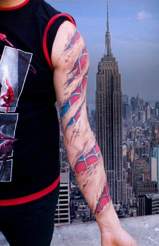 Tattoos make this guy seem more super than he appears. Picture: Lippo tattoo