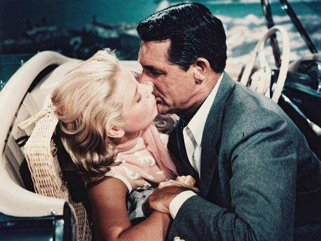 Grace Kelly and Cary Grant kissing in the front seat of a car in To Catch a Thief. Picture: Getty