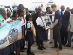 <p>Prince Harry accepts gifts from the school children in Nassau, Bahamas.</p>  <p>Picture: Getty</p>