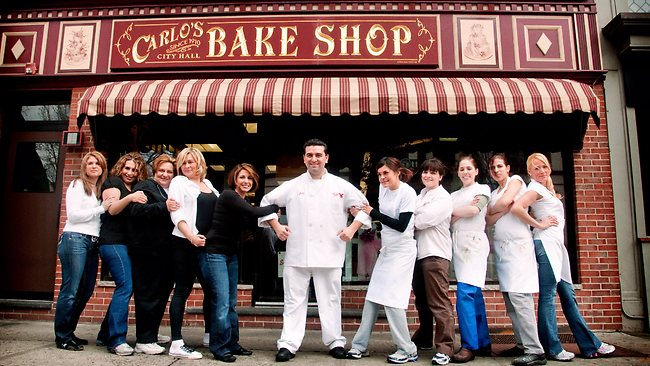 Carlo's City Hall Bake Shop owner Buddy Valastro poses with cast from reality TV series Cake Boss. Picture: Supplied