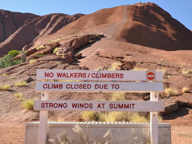 "The ""closed"" sign at the base of Uluru. Picture: Zach Hope"