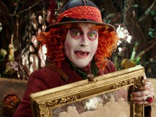 "In this image released by Disney, Johnny Depp portrays the Hatter in a scene from ""Alice Through The Looking Glass."" (Disney via AP)"