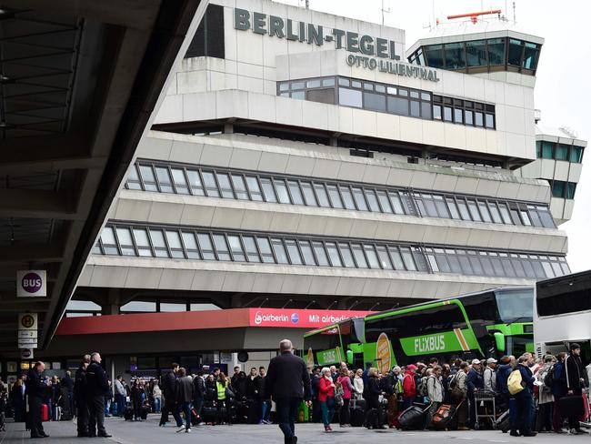 Stranded passengers queue for buses at Berlin Tegel airport during a wage strike of ground staff on March 10, 2017. Picture: AFP/Tobias Schwarz