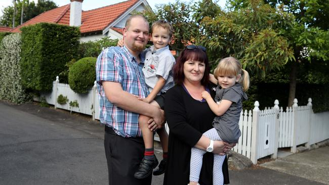 Elissa and Janis Auzins, with kids Alexis and Ben, have bought a new home after a long struggle. Picture: Brianne Makin
