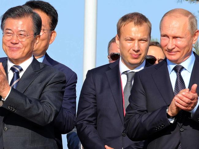 South Korean President Moon Jae-in and Vladimir Putin following a meeting outside Vladivostok yesterday. Picture: Sputnik/Michael Klimentyev/AFP