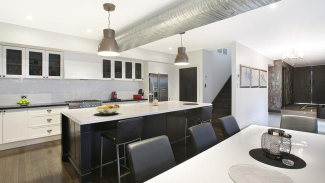 The modern kitchen has a huge butler's pantry, breakfast bar and more.
