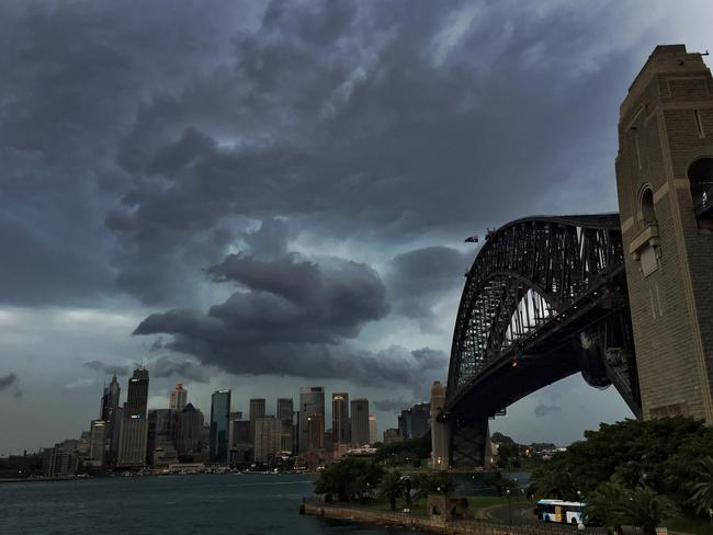 Dark clouds gather over Sydney Harbour Bridge. Picture: Toby Zerna