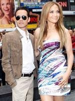 """<p>Meat in the sandwich ... Jennifer Lopez with her husband Marc Anthony before an event unveiling the Boys and Girls Clubs of America's """"Be Extraordinary"""" billboard in Times Square, New York, on Thursday, June 10, 2010. (AP Photo/Jason DeCrow)</p>"""
