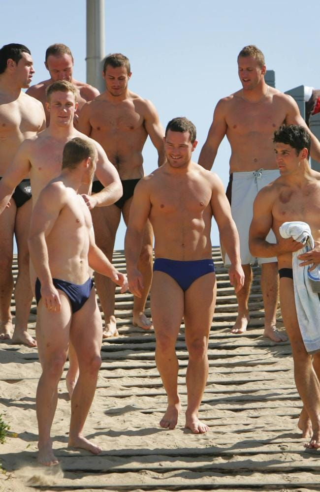 On top of the list... Aussie NRL players at a recovery swim at North Cronulla beach.
