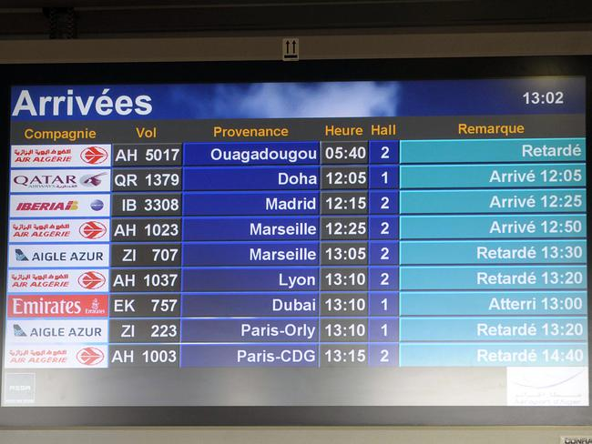 No sign ... an arrival information screen shows the delayed Air Algerie flight 5017 (top) at the Houari Boumediene airport near Algiers, Algeria.
