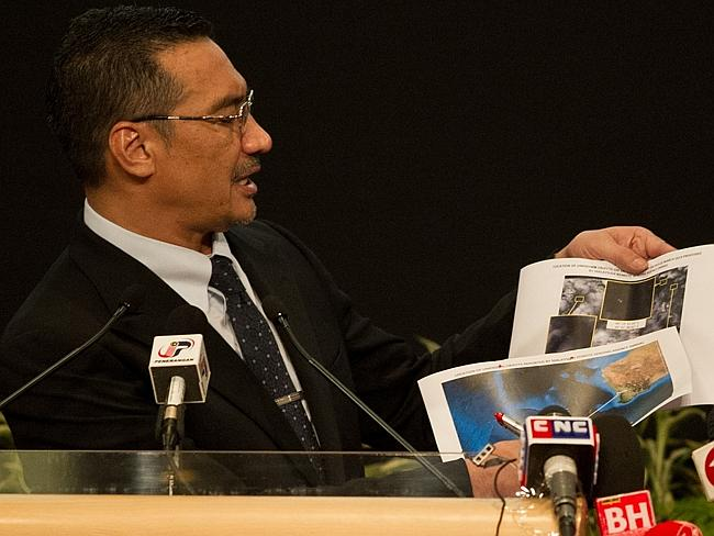 Criticism....Malaysian Transport Minister Hishammuddin Hussein shows pictures of possible debris off the coast of WA as he said history will judge Malaysia's handling of the crisis well. Picture: AFP