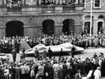 Motor car racing - record attempts by land speed record-breaking car 'Bluebird' driven by Donald Campbell. Campbell parades his car past crowds as he departs Adelaide Town Hall, 25 Jul 1964, after setting land speed record on Lake Eyre. (Pic by staff photographer Dick Joyner) Picture: Advertiser Library