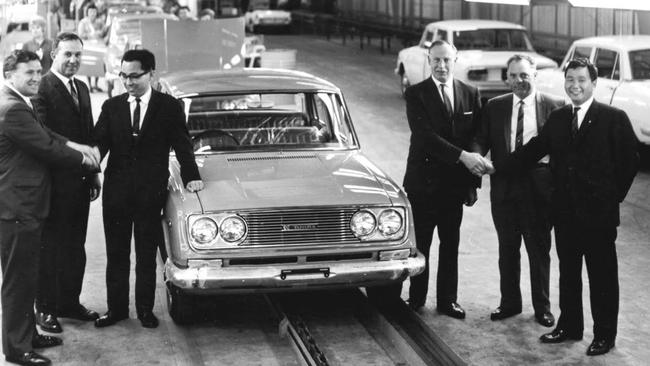 Workers celebrate the production of the 10,000th Australian-made Toyota in the late 1960s. Picture: Supplied.