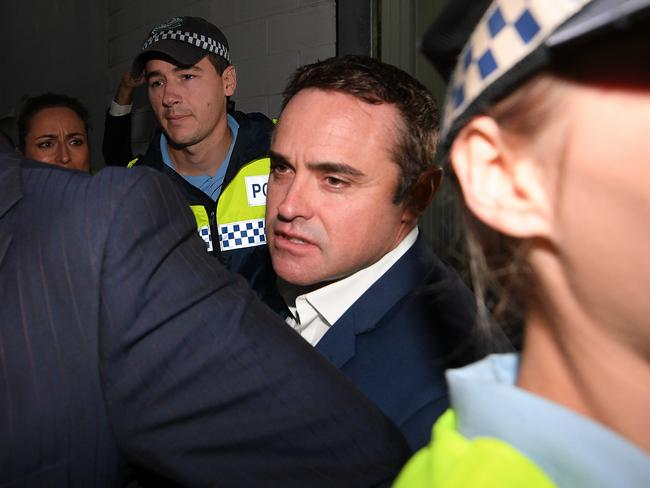 Nine Network reporter Ben McCormack is released from Redfern police station yesterday after being charged with sending child pornography material. Picture: AAP Image/Dan Himbrechts