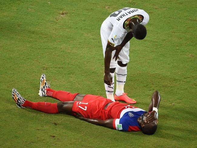 Ghana defender Jonathan Mensah deals with a shocking sock injury, while US forward Jozy Altidore simply can't bear to watch.