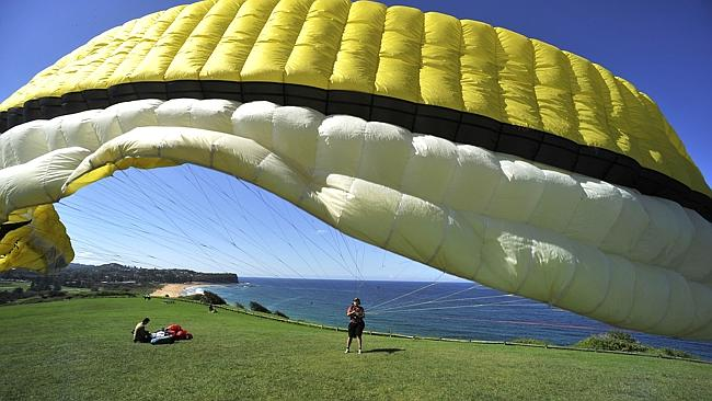 This is the paraglider in his yellow wing before trying out his red rig, with which he cr