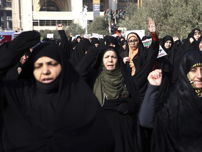 Iranian protesters chant slogans at a rally in Tehran, Iran. Picture: AP