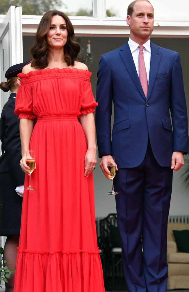 Kate turned heads in this scarlet-red Alexander McQueen frock in Berlin (and note the colour of Wills' tie). Picture: AFP