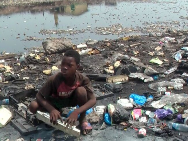 Children as young as five live on the world's biggest computer waste dump where they contract diseases and skin sores which see many of them die young. Picture: Mike Anane/Radio National.